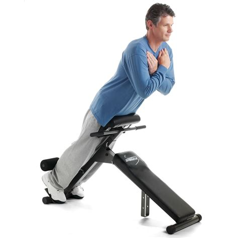 bench press lower back the foldaway abdominal and back exercise bench hammacher