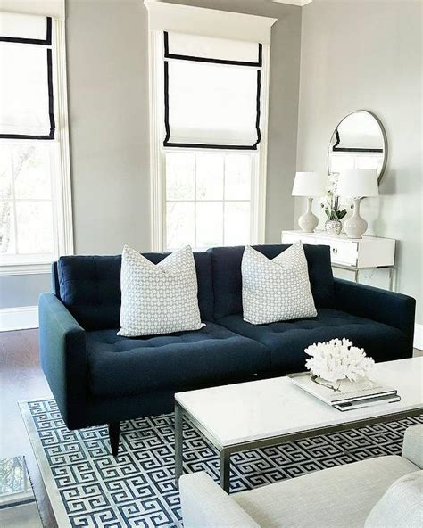 key west sectional living room in gray living room mor navy blue tufted sofa with blue greek key rug