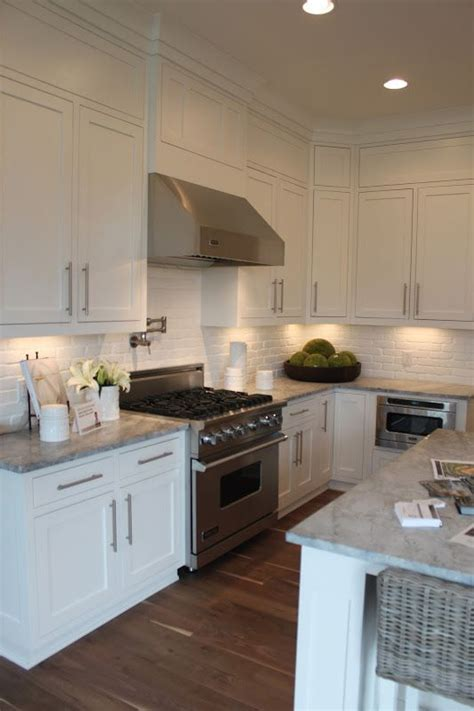 brick backsplash in kitchen brick backsplash white kitchen updating cabinets molding pinte
