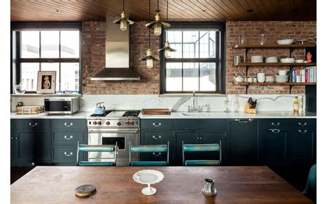 kirsten dunst apartment the kitchen s marble countertops add to the brick walls while rent kirsten dunst s new
