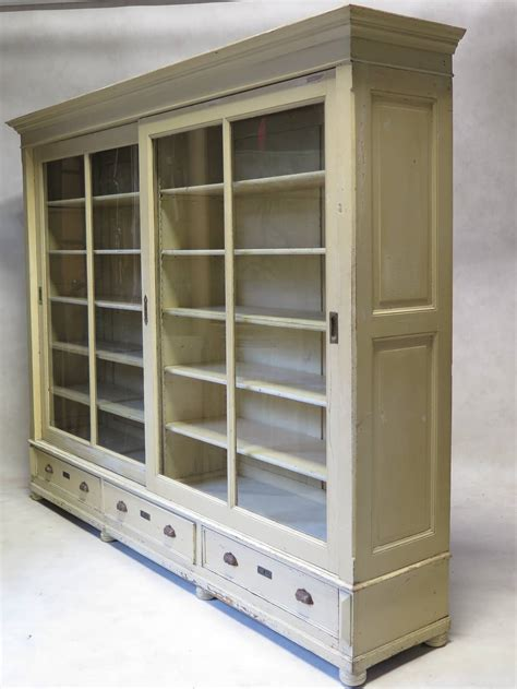 bookcase with sliding glass doors early