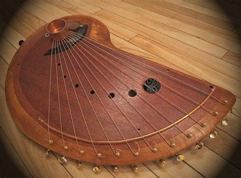 handmade wooden musical string instrument harp like sound