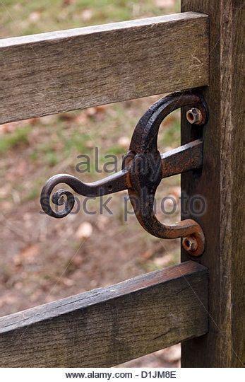 stylish ornate wrought iron wooden gate latch  curves