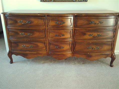 Sleek diy old dresser with small rack beetwen big rack on white carpet plus plain color wall and