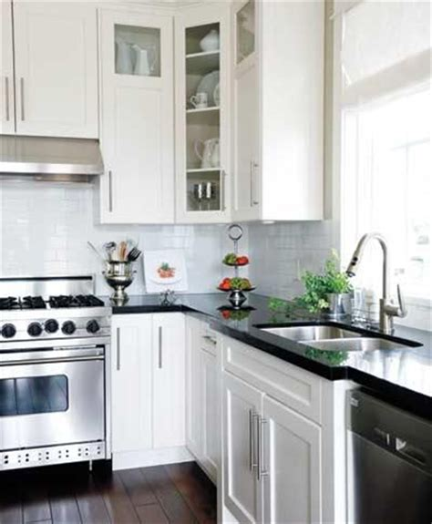 kitchen white cabinets black granite i m keeping this one black countertops white cabinets