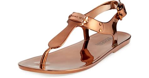 mk jelly sandals lyst michael michael kors mk plate jelly sandals in brown