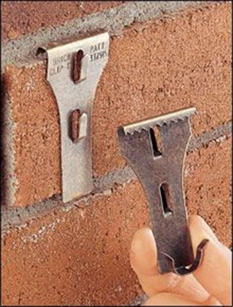 how to hang stuff without holes patio porch hang things on brick without drilling holes
