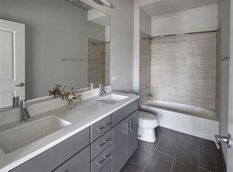beautiful model bathroom featuring gray cabinets