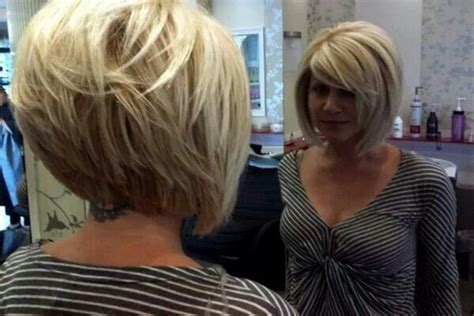 long graduated layers with a side angled or sweeping bang modified bob with graduated layers short hairstyle 2013