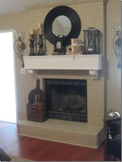 Brick Fireplace Mantel Decor by Fireplace Decor Mirror Candles Lantern Clock On A
