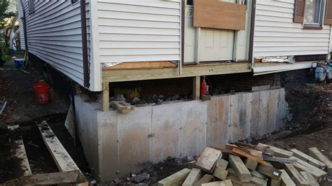 new home foundation stabilizing a settling and buckling foundation
