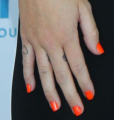 miley cyrus cross tattoo miley cyrus cross on finger check out