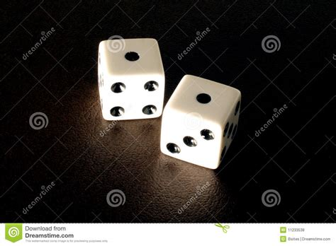 Tiff Eye Roll rolling snake on a pair of dice stock photo image