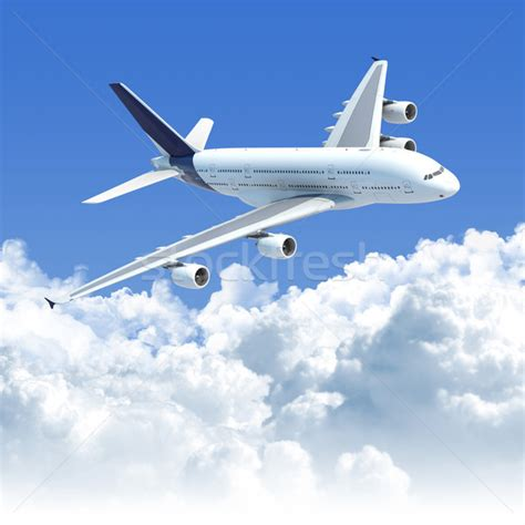flying plane airplane flying the clouds stock photo 169 pablo scapinachis armstrong