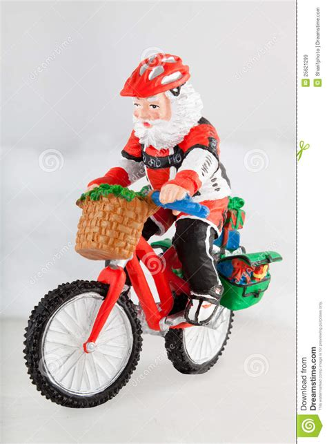 miniature santa claus on bike stock image image 25621299