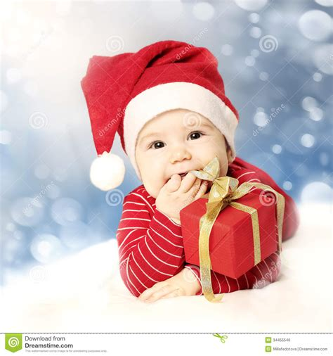 happy baby new year happy new year baby with gift on snow royalty free
