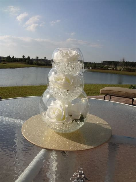Handmade Wedding Centerpieces - i like this centerpiece idea you could each level