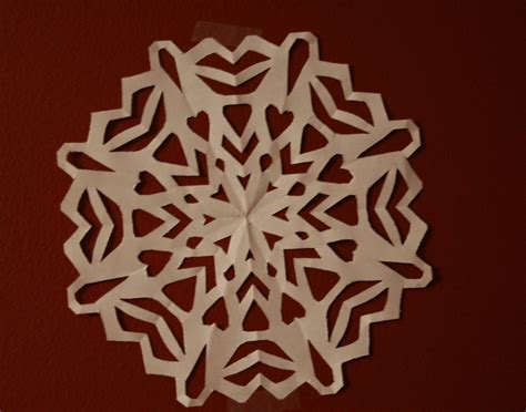 Snowflakes Out Of Paper - decorating for less paper snowflakes