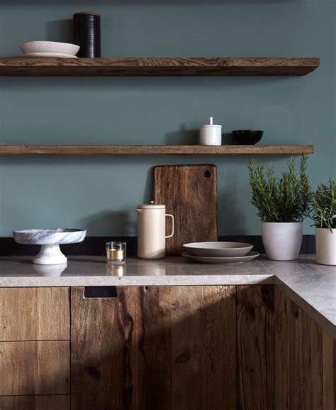 blue modern wooden kitchen designs mid tone wood cabinets floating shelves