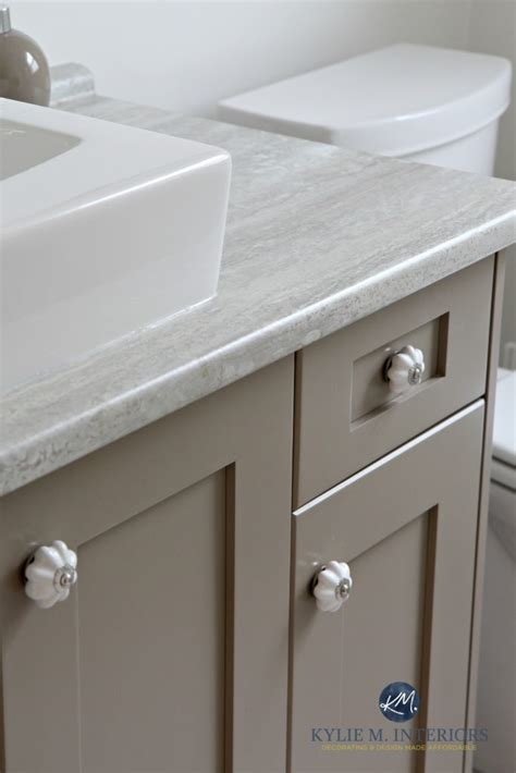 Bathroom vanity with travertine silver countertop, painted