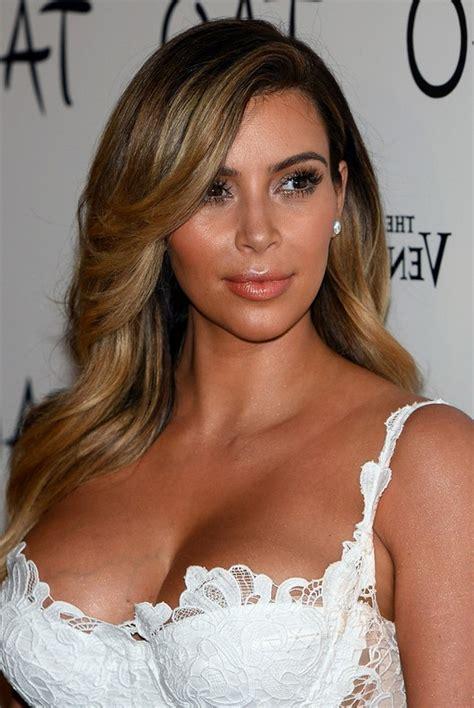 updated flip hairdo would you wear a faux hawk like kim kardashian male