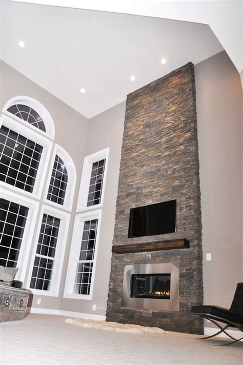 fabulous floor to ceiling stacked stone fireplace design decorating a modern fireplace ideas inspiration