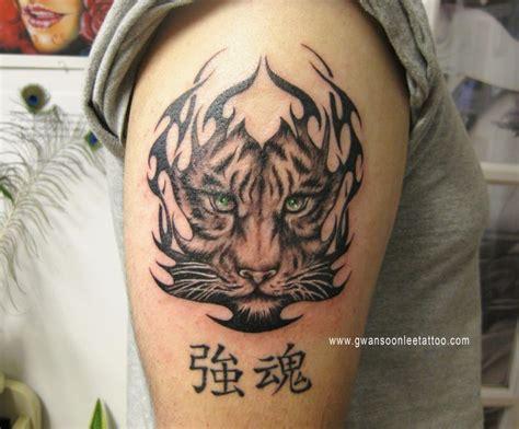 tiger tattoo with tribal design tattoo gwan soon lee