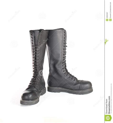 new knee high lace up black combat boots stock photo