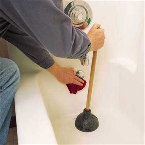 how to fix a clogged bathtub drain snake a tub drain block overflow plate how to clear any clogged drain this old house