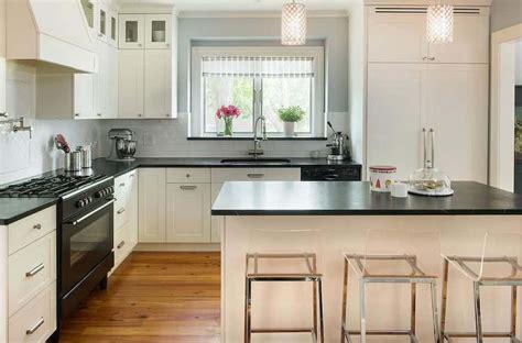 great kitchen  white cabinets  black slate