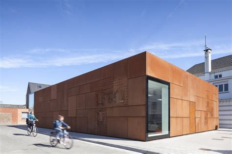city library bruges new rusty facade gets more beautiful
