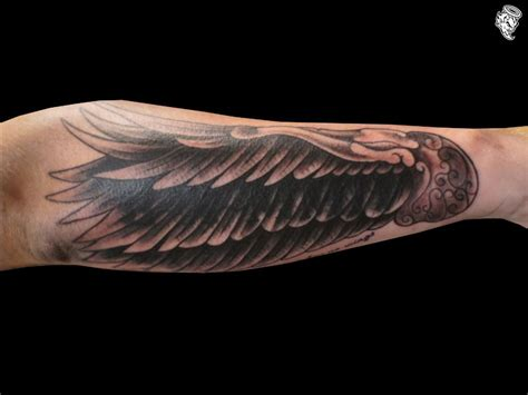 angel wing tattoo on forearm wing on forearm arm wing