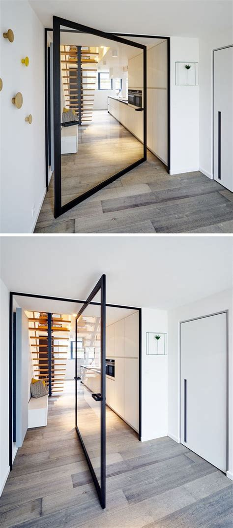 Cool Designer Plunket Pivet by This Glass Pivot Door Has A Unique Central Pivoting Hinge