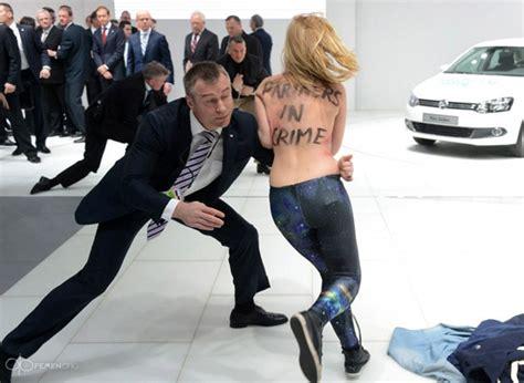 watch topless femen protesters attack putin and merkel