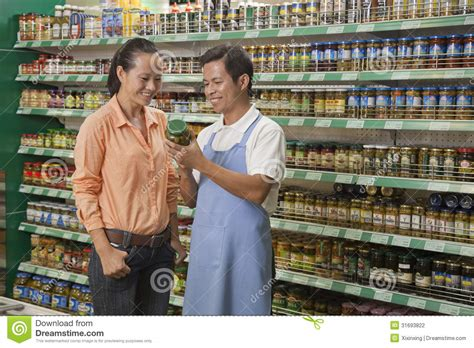 Sales Clerk by Sales Clerk Assisting Examining Jar In The Supermarket Beijing Stock Photography Image