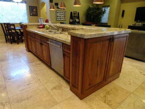 kitchen island with sink and dishwasher and seating if you