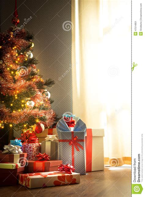 traditional christmas tree with gifts stock photo image