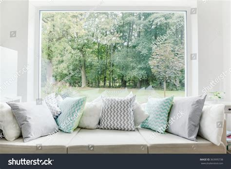 window sofa window sofa white room with sofa and green landscape in