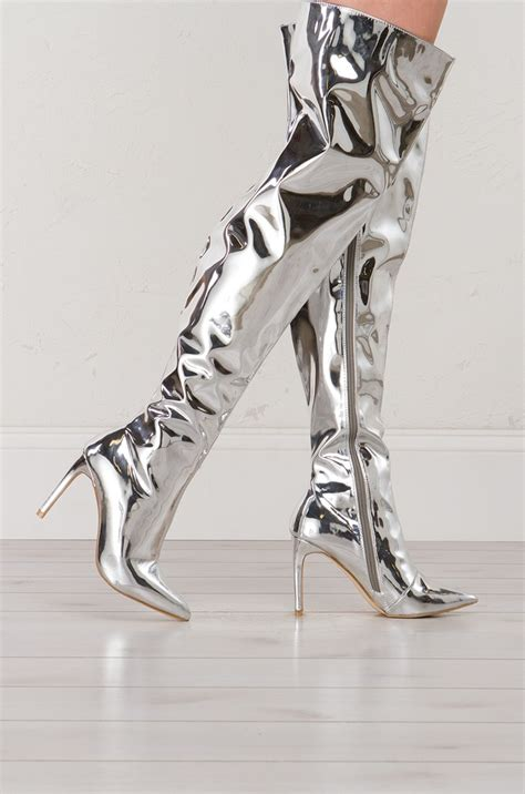 metallic thigh high boots in silver and gold