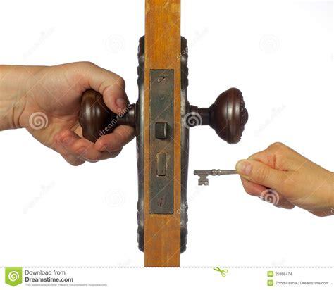 unlock door key download man driver unlocking or locking old antique door being open with skeleton key stock photo
