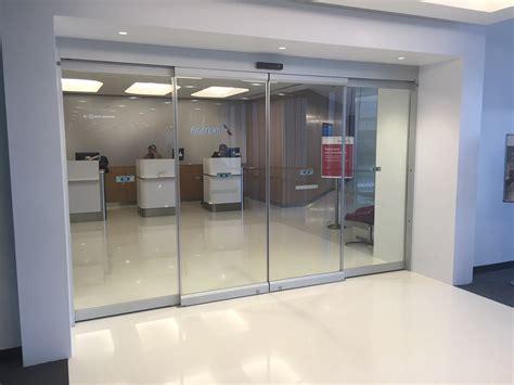 aa admirals club all glass sliding automatic door dash door