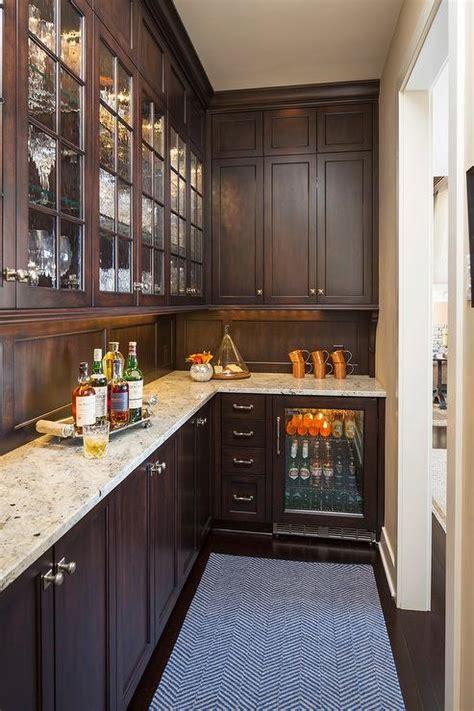 brown pantry cabinets  crema persa granite countertops