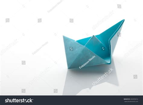 Origami Cruise Ship - origami paper ship on white background stock photo