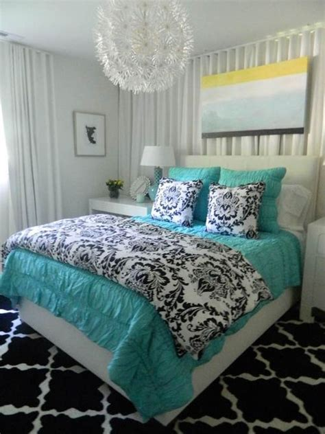 beautiful bedroom with turquoise bedding and accents for