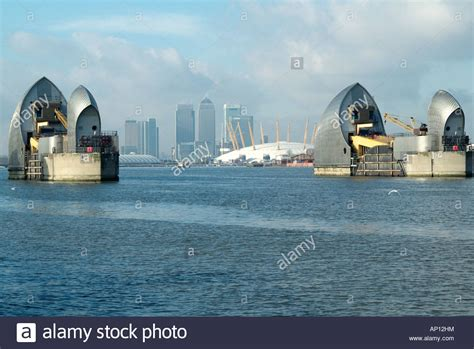 thames river boats from woolwich river thames barrier flood defence woolwich london england