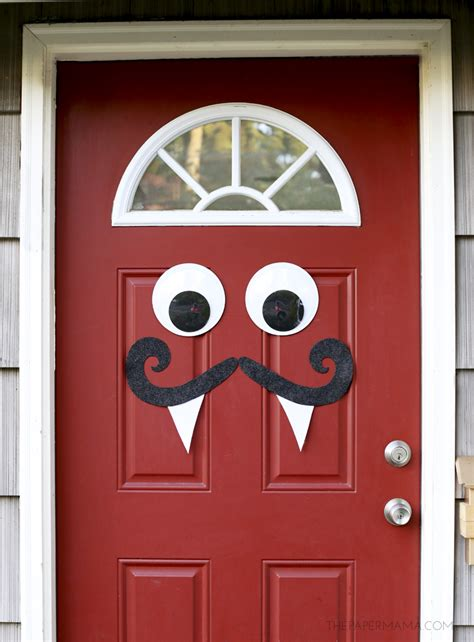how to make halloween decorations at home mustache and googly eyes door decor