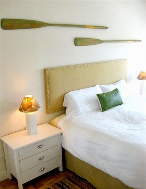 how to hang oars or paddles in an x shape the inspired how to hang oars and paddles on a wall like a pro http
