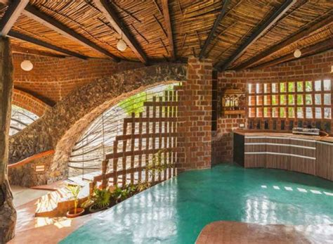light brick house curvaceous brick house uses passive cooling and local materials in india inhabitat