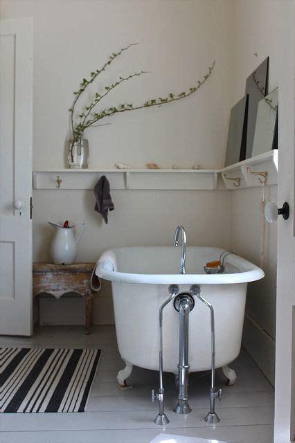 clawfoot bathtub shelf sydney shelves for bathroom clawfoot tubs and striped rug