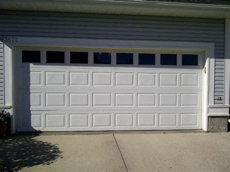 insulated garage doors with windows standard double wide insulated steel garage door with